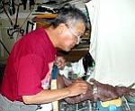 Photo courtesy of Flagstaff Cultural Partners  Baje Whitethorne Sr. at work in his studio.