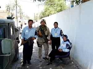 Courtesy photo Jared Shupla, with Iraqi police including two of the first Iraqi female officers he helped train.