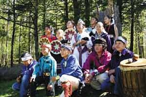 Photo by Daniel Tate <BR><BR> Shonto Preparatory School students dressed in their traditional Navajo regalia in Ithaca, N.Y. after a May 8 performance at the Cayuga Nature Center.