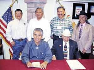 Photo by George Hardeen, Navajo Nation Communications Director/ Following the signing of the proclamation to set aside Sept. 8 as the day for the Navajo Nation Exceptional Rodeo during the 59th Navajo Nation Fair, from left to right, front are President Shirley and Vice President Dayish. Back row from left are Ray Russell, director of Navajo Parks & Recreation, Navajo Supreme Court Justice Herb Yazzie, Navajo Nation Council Speaker Lawrence T. Morgan and Navajo Nation Council Resource Committee Chairman George Arthur.