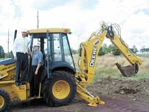Ann Widmann/Observer <BR><BR> David Beckham, left, in development with Westcor, and Paul Lancaster, media consultant for KOLT Radio, were on the backhoe for the ceremonial first scoop at the Aug. 25 Flagstaff Mall groundbreaking for a major addition and remodel.