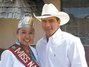 Photo courtesy of Office of Miss Navajo Nation   2005-06 Miss Navajo Nation Rachelle Marie James poses with Professional Bull Rider Adriano Moraes.