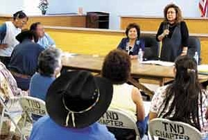 S.J. Wilson/Observer  Two residents, left, talk to Tuba City Chapter President Frank Biligody, while Cora Phillips explains Navajo Nation efforts in Washington on behalf of uranium victims. Coconino County Supervisor Louise Yellowman, seated at center,  chaired the informational meeting.
