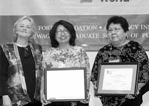 Photo by Phil Gallo. Ford Foundation President Susan V. Berresford, left, presents a Leadership for a Changing World award to Loris Ann Taylor and Barbara A. Poley of ArizonaÕs Hopi Foundation.