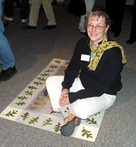 Ann Widmann/Observer Sitting on one of the rugs she created for the show Flagstaff artist Elaine C. Dillingham poses at the Nov. 10 ÒItÕs Elemental Fine Craft ExhibitionÓ at Coconino Center for the Arts.