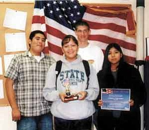 Photo by Stan Bindell  Hopi High School Junior ROTC cadets display their winning trophy from the Mesa Parade. They are William Thompson, left, Dordale Tsosie, Alex Weber andLauren Lomatska.