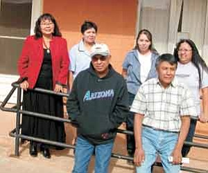 Photo by George Joe  Leupp School Inc. officials and staff pose for a photo outside the administrative offices including, (first-row left) Facility Operations Manager Henry Begay and NAHASDA Project Coordinator Jasper Lee; (second-row left) Administrative and Support Service Director Lorraine Jones-Noline, Business Manager Lola Cody, Payroll Technician Corrina Paul and Accounts Payable Technician Marilyn Reddye.