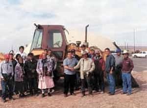 Courtesy of El Paso Western Charles Scott Curtis of El Paso Gas presents the Case backhoe to Birdsprings Chapter President Eddie Kee Yazzie.