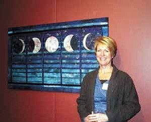 """Ann Widmann/Observer<BR><BR> Flagstaff fiber artist Arline Martin stands in front of her quilted piece """"Phases of the Moon"""" at the Oct. 10 opening of """"It's Elemental Fine Craft Exhibition"""" at the Coconino Center for the Arts. The center is hosting a fine craft sale on Saturday from 11 a.m.-4 p.m. featuring works by the artisans on exhibit."""