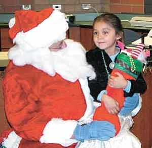 Photo by TC Media Team,  Making the trip all the way from Flagstaff to Gap, this Santa brought gifts to the architecturally award-winning school, Tsinaabaas Habitiin, one of the seven schools that belongs to TCUSD #15.