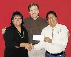 Photo courtesy of HEEF HEEF Executive Director LuAnn Leonard, left, Trail of Painted Ponies President Rod Barker and Hopi artist Buddy Tubinaghtewa hold the $25,000 check the Painted Pony netted at a recent Scottsdale auction.