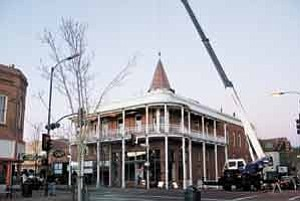 Photo by Bonnie Stevens On Nov. 19, Weatherford Hotel owners Henry Taylor and Sam Green replaced the ornamental cupola, or witches hat, that once graced the historic edifice.