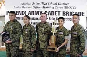 Rosanda Suetopka Thayer/TC District Media Tuba City High School Warriors took the Arizona State Championship for Marksmanship and achieved number one ranking in the First Round of National Junior ROTC Sharp shooting. Pictured are Garrett Begay, left, 10th grade, Navajo Nation, First Place Gold Medal; Ashley Manygoats, 10th grade, Navajo Nation, First Place Gold Medal, Second Place Standing Position Silver Medal; Gunnery Sgt. Tim J. Shaner, 12th Grade First Place Coaches Gold Medal; Darrin Talawepi,11th grade, Hopi Tribe, First Place Gold Medal, Third Place Overall Individual Bronze Medal, Third Place Standing Position Bronze Medal; and Charles Lee,11th grade, Navajo Nation, First Place Gold Medal, Second Place Overall Individual Silver Medal, First Place Prone Position Gold Medal, First Place Standing Position Gold Medal.