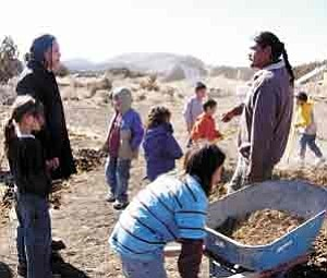 S.J. Wilson/Observer<BR><BR> Winona LaDuke, left, listens as Justin Willie describes an ongoing permaculture project at the STAR School, located northeast of Flagstaff. LaDuke visited the school on Feb. 16.