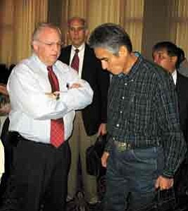 Photo by George Hardeen BIA Director Jim Cason and Navajo President Joe Shirley Jr. share a few private thoughts following the first morning session of the BIA National Budget Meeting in Washington, D.C. Behind them is Office of Special Trustee head Ross Swimmer and  Navajo Division of Community Development Director Arbin Mitchell.