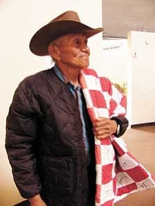S.J. Wilson/Observer Harold Wagoner proudly wears the quilt awarded to him for the effort he makes to participate in the Senior Citizen program at Birdsprings. Wagoner makes the journey on foot most days.