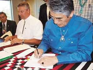 Photo by Chris Burnsides/DPA Public Relations Navajo Nation Vice President Frank Dayish Jr., left, Dirk Straussfeld, Vice-President Desert Rock Energy Company LLC, andNavajo Nation President Joe Shirley Jr. at the signing ceremony for the Desert Rock Energy Project on May 25.
