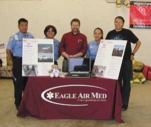Courtesy photo Chinle EMS and Eagle Air Med Celebrate National EMS Week at an Open House at the Chinle Fire Station. From left to right are Everrick Coggeshall, EMT-Intermediate, Jereline Begay, EMT-B, Eric Niven, Eagle Air Med, Jerlyn Thomas EMT-B and Angelita John EMT-B.