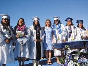 Photo by Stan Bindell Beth Giebus recognizes the ÒProtecting You, Protecting MeÓ students during Hopi High graduation.