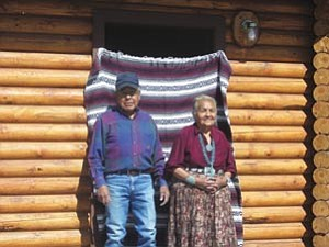 Photo by Hazel James Navajo Elders Stephen and Rose Smith Smiths in front of their new their new Hooghan home in Sawmill with  a modern kitchen and appliances, a bathroom with handicapped accessories, a utility room and one bedroom.