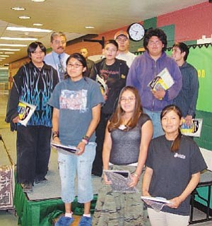 2006 TC High Excellent Year Awardees: back-row left, Dennis Bowen-TC Wellness Coordinator; middle-row, left, Adelbert Goldtooth, Principal TCHS, Harry Yazzie, Cruz Walker, Channing Yazzie, Valentina Nez, Anastasia Polacca, Shavale Scott, Ryan Begaye, Uriah Yellowhorse.