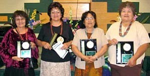 Photos by Sara Adson Recognized at TCUSD for their long-term service to their studentsÕ educational enrichment and growth are, from left, Susie Store, 25 years; Mildred Yazzie, 25 years; Lulu Adson, 40 years of teaching and Juanita Sombrero,40 years of office work.