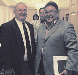 Photo courtesy of NACOG NACOG Executive Director Kenneth Sweet, left, congratulates Apache County District II Supervisor Tom M. White Jr., who was elected chairman of the organization's regional council on June 22.