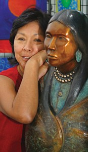 Photo courtesy Prescott Indian Art Market This year's featured artist Evelyn Fredericks, (Hopi) from Santa Fe, N.M., poses with one of her  stone and bronze sculptures.