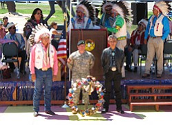 Photo by George Hardeen  Tex Hall, chairman of the Mandan, Hidatsa and Arikara Tribe, Lt. Col. Rick Steiner of the 10th Special Forces Group, and Navajo President Joe Shirley, Jr., lay a wreath at the wall of the Apsáalooke Veterans Commemorative Park on June 23 at the Crow Agency, Montana.