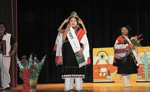 Photo provided courtesy of the Miss Hopi Pageant Committee. Tiffany Bahnimptwa is crowned Miss Hopi 2006-07 by the former Miss Hopi, Jessica Onsae, while Clark Tenakhongva (left) master of ceremonies and First Attendant Juanita Yaba White look on.