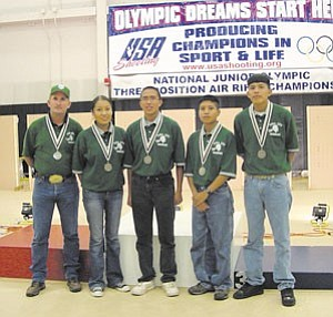Rosanda Suetopka Thayer/TC District Media 2006 TC High Marine Corps Junior ROTC Marksmanship Team took 2nd Place at the National Olympic Championship.ÊFrom the left are Gunnery Sgt. Timothy Shaner, teacher/sponsor, Ashley Manygoats, Charles Lee, Darrin Talawepi and Darrell Robbins.