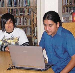 n Chacon, far right, is the 2006 Grand Canyon Music Festival's Composer in Residence for the Native American Composer's Apprenticeship Program working with Native students interested in musical composition.  Chacon is seated in the Tuba City High School library with Krystyn Tallsalt, a NACAP studentsforom Tuba City High.
