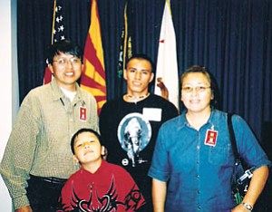 Courtesy photo Navajo Nation presidential candidate Lynda Lovejoy recently picked Walter Phelps as her vice presidential running mate. The Phelps family includes Walter, left, his wife, Sharon, and sons Wayne and Dakota Phelps. Wayne is currently serving with the Marine Corps. Dakota is home schooled by his parents.