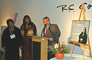 "NAU President John Haeger honors R.C. Gorman's sister Donna Scott, left, and cousin Tanya Gorman Keith while unveiling a plaque honoring R.C. Gorman's sculpture ""Natoma II"" during the opening reception for ""R.C. Gorman: 1931-2005."" A commemorative art show will be on display at the NAU Art Museum through Dec. 16 (Photo by Diane Rechel/NAU)."