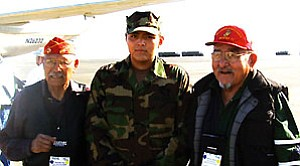 Tactical Squadron (VTC) 12 Operations Specialist Seaman Michael Benally and two Navajo Nation code talker veterans pose during the 61st Battle of Iwo Jima Commemoration (U.S. Navy Photo by Cmdr. Paul Williams. Released).