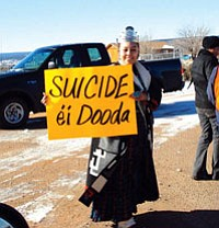 "Miss Navajo Nation Jocelyn Billy holds up a sign saying ""No suicide"" in the Navajo language. Billy participated in a march from Fort Defiance to Window Rock on Nov. 30 to bring awareness to Navajo Nation officials regarding the serious lack of resources for suicide prevention (Photo by Amanda Moore/NNDOY)."