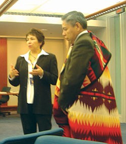 Dorothy Dupree honors Navajo Nation Vice President Frank Dayish with a gift for his service to the Tribal Technical Advisory Group (Photo couresy of Maxine Etter).
