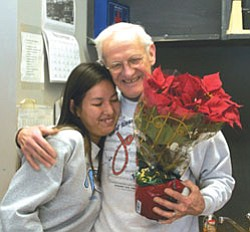 CCC's 2006-2007 Teacher of the Year Don Bendel receives the news of his award and a hug from student Shantelle Harker.