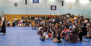 Miss Navajo Nation Jocelyn Billy (above left) addresses the large crowd at the Tonalea School Wellness Fair held Dec. 13 in Tonalea (Photo by Christopher Curley).