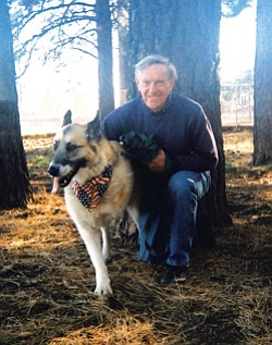 "Jack and his handler, the self-proclaimed ""man on the end of the leash,"" Richard Gliebe."