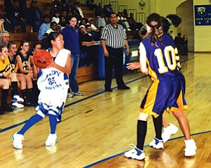 Hopi's Samantha Lucas gets ready to pass the ball during the Blue Ridge game on Dec. 12 (Photo by Stan Bindell).