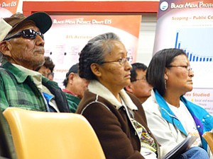Woody Smith and daughters Irene and Juanita were among at least 70 individuals who attended the Black Mesa Project Draft Environmental Impact Statement public meeting on the evening of Jan. 9. Smith has frequently spoken out against the C-aquifer well field proposal that would take place in his community (Photo by S.J. Wilson/Observer).
