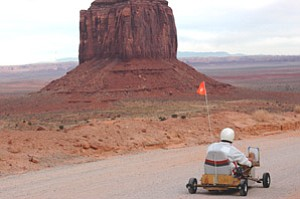 Navajo artist Steven Yazzie on location in Monument Valley during the filming of Draw Me a Picture in 2006 (Photo by Nicole Haas, courtesy of the Heard Museum).