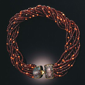 Yazzie Johnson (Navajo) and Gail Bird (Santo Domingo/Laguna), Garnet and coral necklace with Yowah opal clasps, 18k gold, 1999, 16 inches length. Private Collection (Photo courtesy of the Heard Museum).