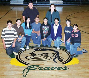 Winning TCJHS Wrestling Team: All placed in the recent 2007 Tuba Boarding School Wrestling Invitational. Pictured from L to R: Jason Begay, Cordell Claw, Stephanie Savusa, Austin Scott, Bavatya Dawavendewa, Lyghton Butler, Urian Lee, Dariul Shorty with assistant coach Ace Black, center Head Coach Sanora Isaac, assistant coach Brandon Wilson (Photo by Byron Poocha).