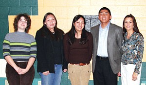 Tuba City High students who have exceeded in all three areas of AIMS testing this year include (from left): Jessica Goatcher, Ashley Brown, and Mia Henderson standing with tribal role model, Dr. Joe Chino and his wife, Jenniferat this past week's AIMS Honor Banquet held atTC High's Warrior Pavilion.Not pictured, but also exceeding all three areas of AIMS are Chris Holve and McKenzie Butler (Photo by Byron Poocha).