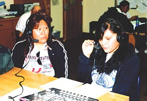 Jessica Quamahongnewa is interviewed by Traci Talahytewa on Hopi radio station KUYI (Photo by Stan Bindell).