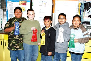 Fifth Grade Science Fair Winners: Allen Joe, First Place, Joseph Justice, Second Place, Nakona Scott, Third Place, Andrew Tso, Fourth Place, and Kiana Begay, Fifth Place (Photo by Byron Poocha).