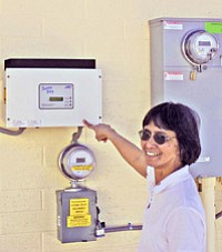 Sister Frances Vista explains the metering system accompanying the solar panel recently installed at the St. Jude Food Bank in Tuba City (Photo by Rebecca Schubert/Observer).