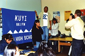 Traci Talahytewa is interviewed by KNAZ's Brett Cox while her fellow students proudly hold up the KUYI sign (Photo by Stan Bindell).